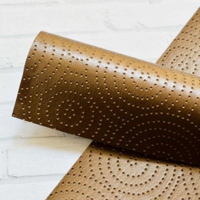 Отрез кожзама с текстурой круги 33х50 см, цвет бронза
