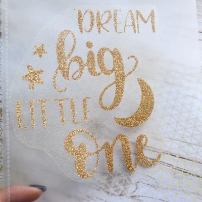Надпись из золотого термотрансфера с глиттером Dream big Little one, 14х15 см