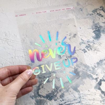 Надпись из серебряного термотрансфера с радужным эффектом Never give up, 12,5x10 см